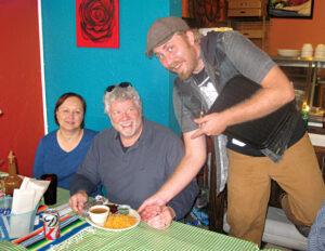 Daniel serves regulars Larry and Francis Keim