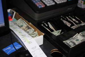 Authorities confiscated cash registers overflowing with monday and receipts.