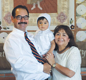 Newly-named La Feria ISD Superintendent Rey Villarreal with wife and educator, Isabel, and grandson Hugo in a photo taken at his recent baptism. Photos: Courtesy of the Villarreal family.