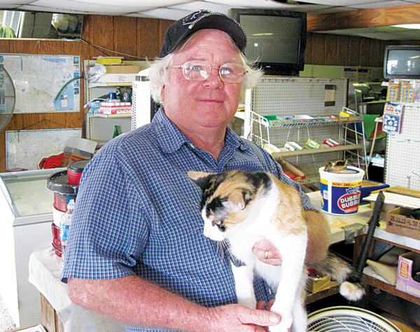 Charles Bertholf, his cats and his Ten-Ten Grocery were a Mercedes landmark for many years. Photo: Bill Keltner/LFN