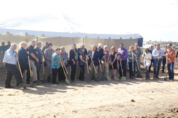 Sunrise Terrace Groundbreaking Ceremony, (l-r):  Commissioner John Hernandez; Mayor Pro-TemLori Weaver; Commissioner John Betancourt; Salomon Torres, Soluciones Consulting; Commissioner Angelica Baldivia; Ana Garcia, Senator John Cornyn's District Director; Betty Jo Dunlap, President La Feria EDC and La Feria Library; Robbie Zapata, President of La Feria Chamber of Commerce; Emma Martinez, STCHD Board Member; Luis Garza, STCHD Board President; Mayor Steve Brewer; Dan O'Dea, President Delphi Housing Group; Gayle Manganello Ellis, Vice President Acquisitions, PNC Real Estate; Sunny K. Philip, City Manager; Carolyn Vela, Manager Sunflower Apartments; Adolfo Lopez, Utility Board Chairman; Erika Williams, Executive Assistant STCHD; Orlando Guerrero, Superintendent, Concept Builders; John Pearcy, Architect, Megamorphosis Design photo by Paula M. Rodriguez.