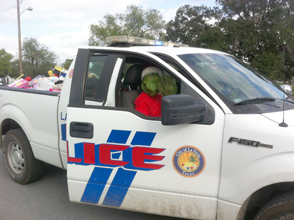 "Even ""The Grinch"" got into the spirit of the season helping Santa deliver toys during Operation Smile."