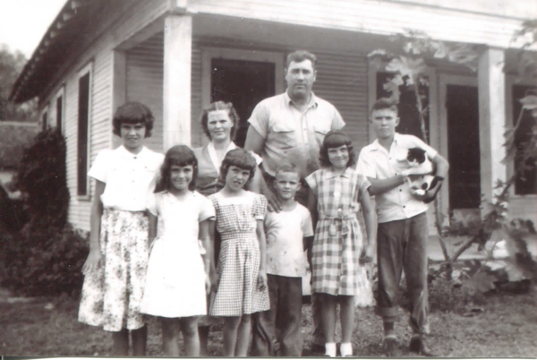 Early Wenke family gathering in La Feria home - Backrow: Georgene, Sally, Carl, and Karl; Front row: Geneva, Vivian, Butch, Clara.