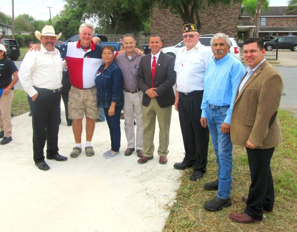 City officials and dignitaries congratulate Navy veteran Gray: (l-r) Judge Mike Trejo,